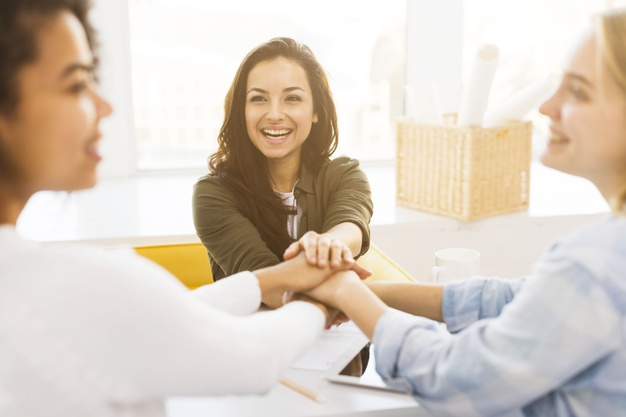 smiley-business-womens-shaking-hands_23-2148461405